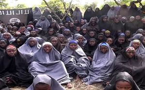 """A screengrab taken on May 12, 2014, from...A screengrab taken on May 12, 2014, from a video of Nigerian Islamist extremist group Boko Haram obtained by AFP shows girls, wearing the full-length hijab and praying in an undisclosed rural location. Boko Haram released a new video on claiming to show the missing Nigerian schoolgirls, alleging they had converted to Islam and would not be released until all militant prisoners were freed.  A total of 276 girls were abducted on April 14 from the northeastern town of Chibok, in Borno state, which has a sizeable Christian community. Some 223 are still missing. AFP PHOTO / BOKO HARAM  RESTRICTED TO EDITORIAL USE - MANDATORY CREDIT """"AFP PHOTO / BOKO HARAM"""" - NO MARKETING NO ADVERTISING CAMPAIGNS - DISTRIBUTED AS A SERVICE TO CLIENTSHO/AFP/Getty Images"""